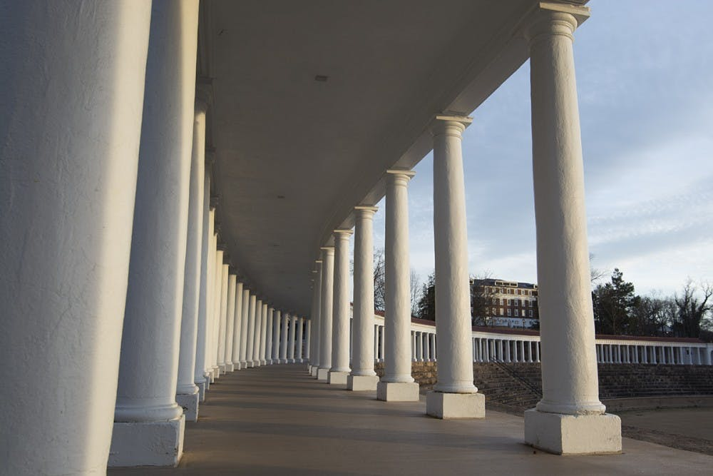 The victim reported that a man holding an unidentified object ordered her to stop on the Colonnades surrounding Lambeth Field.