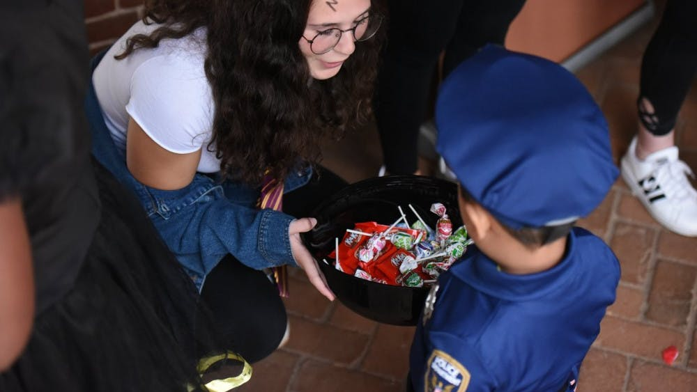 U.Va. students passed out candy to hundreds of children outside Lawn rooms.
