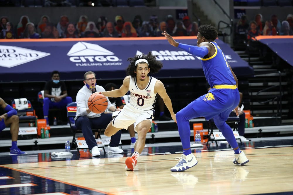 <p>Virginia junior guard Kihei Clark is defended by Pittsburgh junior guard Xavier Johnson.</p>