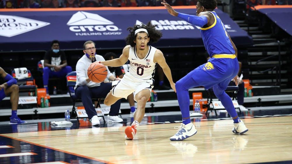 Virginia junior guard Kihei Clark is defended by Pittsburgh junior guard Xavier Johnson.