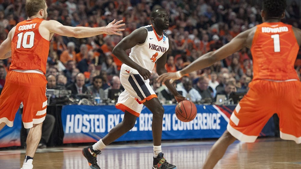 Junior guard Marial Shayok came off the bench to score 15 points Friday night in Virginia's season-opening win against UNC Greensboro.