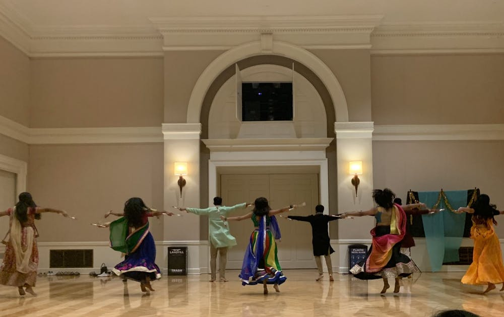 <p>The ballroom was rife with sparkling chatter as attendees relished in delicious food and cheery company but was soon replaced with quiet awe as HooRaas — the University's competitive co-ed dance team that specializes in garba — showcased a performance.&nbsp;</p>
