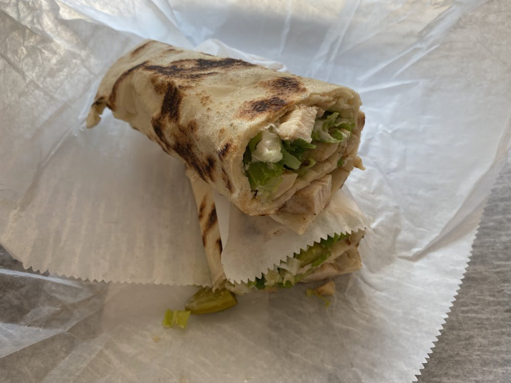 The chicken shawarma flatbread was perfectly crispy, and the garlic sauce mixed well with the tender chicken.