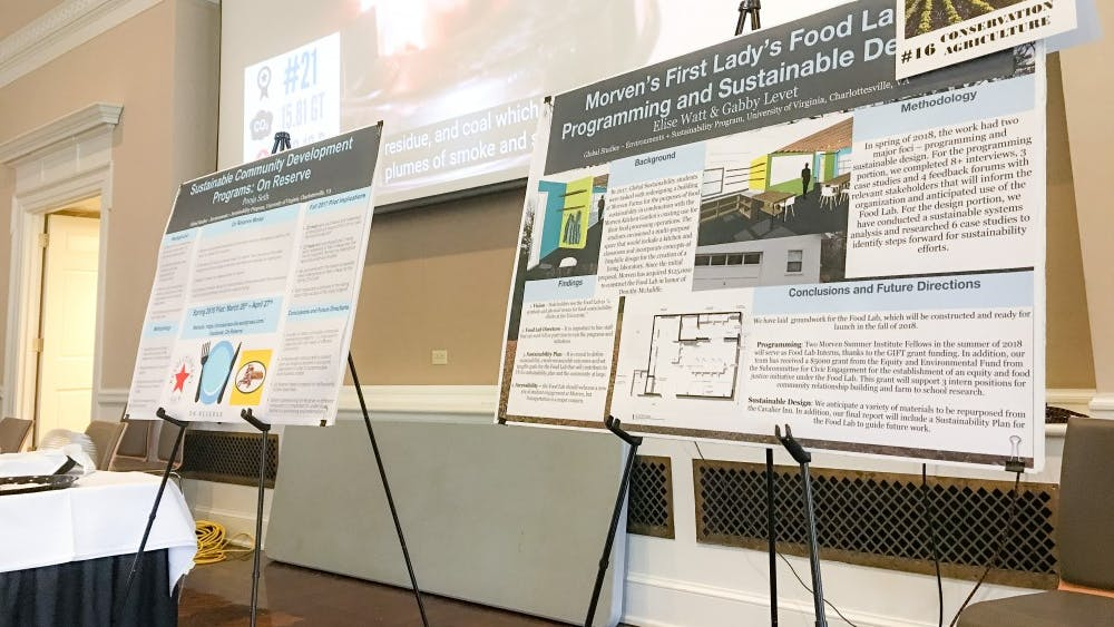 Poster boards at the climate expo display proposed solutions for mitigating climate change.