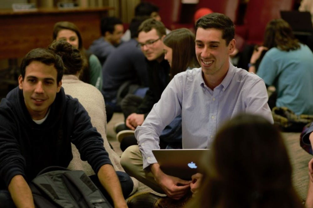 <p>Kevin Warshaw (Right), a fourth-year Engineering student and chair of the University Judiciary Committee, speaks with support officers at UJC meeting this past semester.&nbsp;</p>