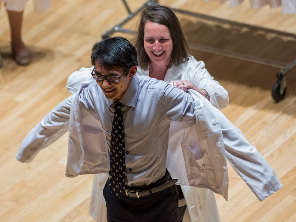 Students are officially welcomed to the School of Medicine by receiving a personally-embroidered white coat.