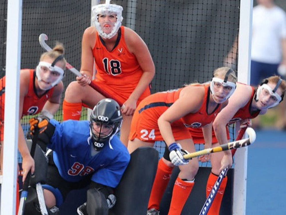 Redshirt senior midfielder Michelle Vittese (9)  recorded an assist in Virginia's 2-0 win at William & Mary, while junior back Elly Buckley (18) led the defense to a shutout.
