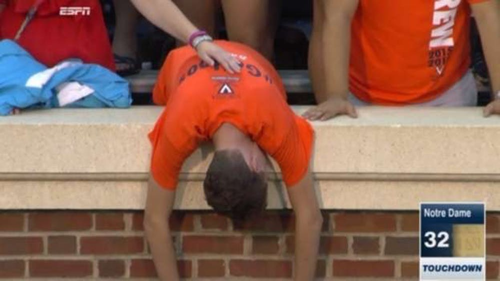 A disheartened University student after Virginia lost to Notre Dame in the fall 2015 football season.