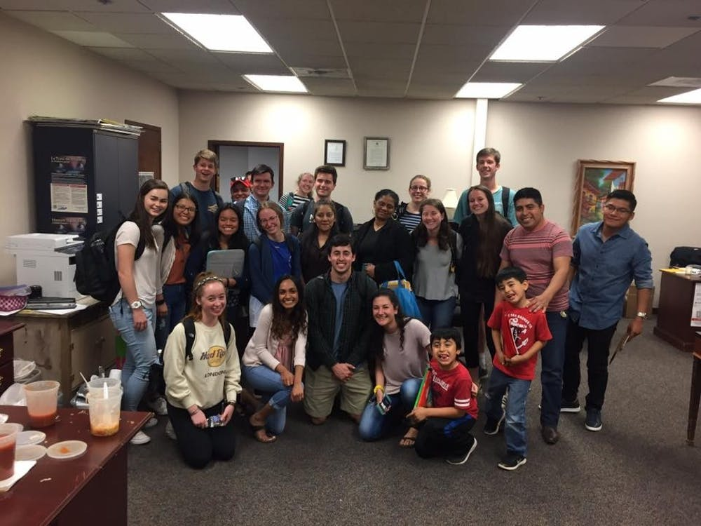 Student volunteers pose with participants in the Sín Barreras program this semester.