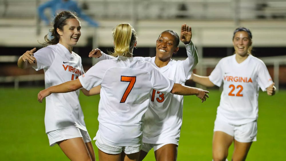 The Cavaliers celebrate an early goal by junior forward Alexa Spaanstra, who guided the team to a 2-0 win against No. 13 Louisville Thursday night.