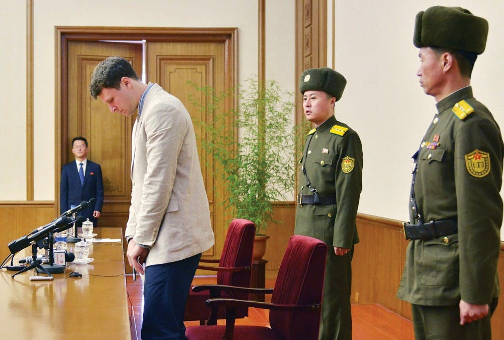 """Otto Frederick Warmbier (3rd R), a University of Virginia student who has been detained in North Korea since early January, attends a news conference in Pyongyang, North Korea, in this photo released by Kyodo February 29, 2016. Warmbier was detained for trying to steal a propaganda slogan from his Pyongyang hotel and has confessed to """"severe crimes"""" against the state, the North's official media said on Monday. Warmbier, 21, was detained before boarding his flight to China over an unspecified incident at his hotel, his tour agency told Reuters in January. Mandatory credit REUTERS/Kyodo ATTENTION EDITORS - FOR EDITORIAL USE ONLY. NOT FOR SALE FOR MARKETING OR ADVERTISING CAMPAIGNS. THIS IMAGE HAS BEEN SUPPLIED BY A THIRD PARTY. IT IS DISTRIBUTED, EXACTLY AS RECEIVED BY REUTERS, AS A SERVICE TO CLIENTS. MANDATORY CREDIT. JAPAN OUT. NO COMMERCIAL OR EDITORIAL SALES IN JAPAN. - RTS8H5V"""
