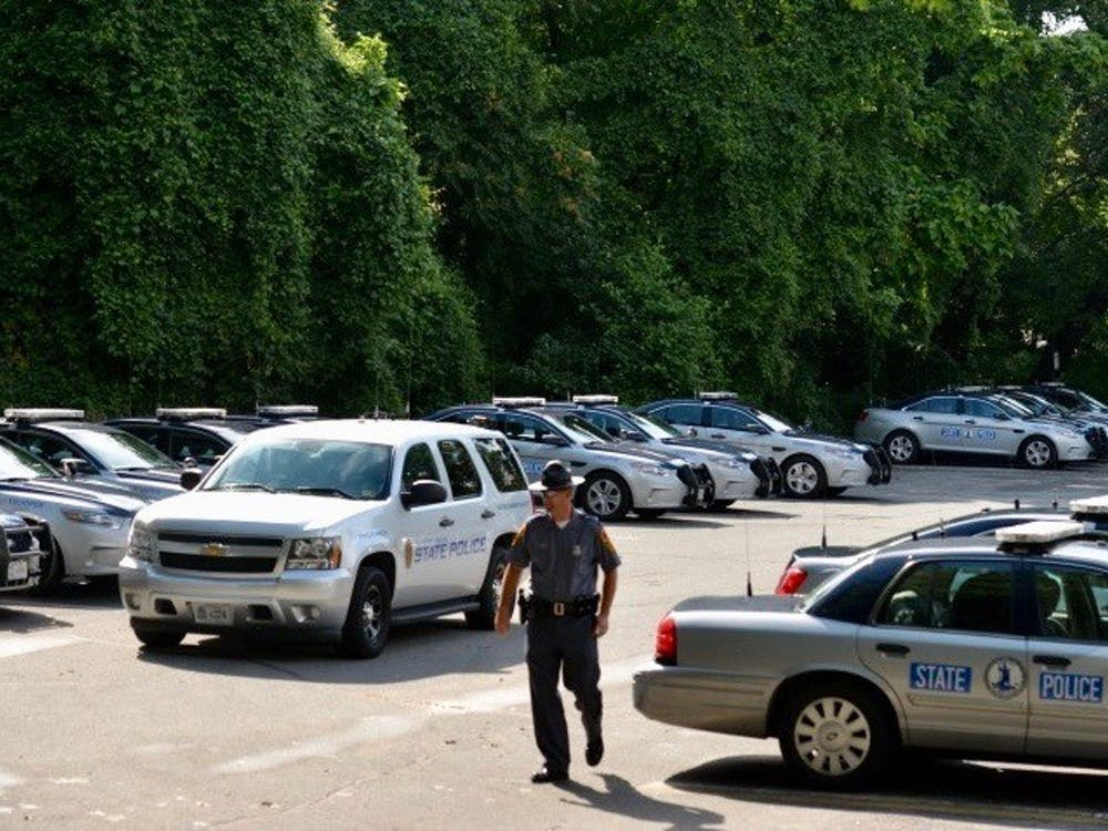 State trooper vehicles stationed in the parking lot beside the Lambeth Field residence area, where many personnel are being housed.