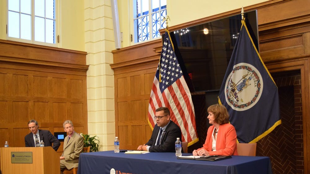 Republican candidateTom Garrett (left) and Democratic candidateJane Dittmar (right) at afifth district congressional debate at the Frank Batten School of Leadership and Public Policy on Sept. 28.
