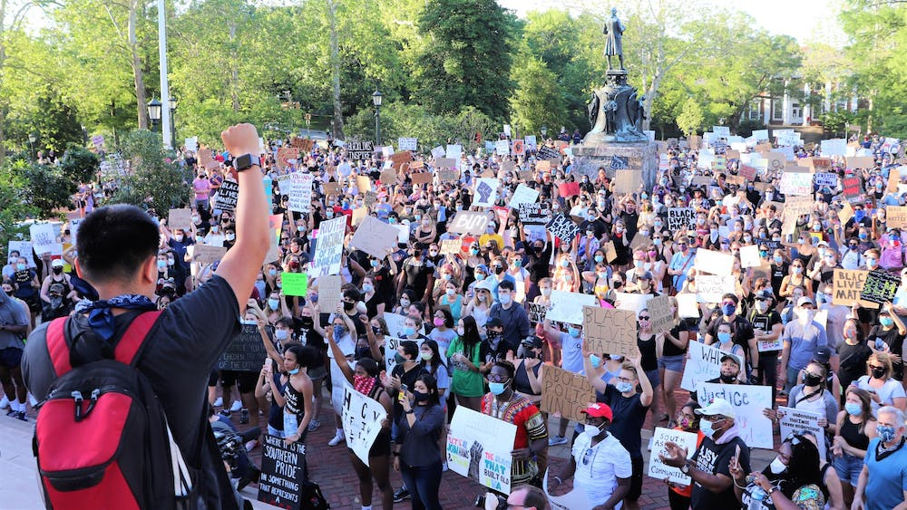 The march to remove Confederate monuments in Charlottesville convened at the Rotunda after marching from downtown. (CD Photo // Geremia Di Maro)