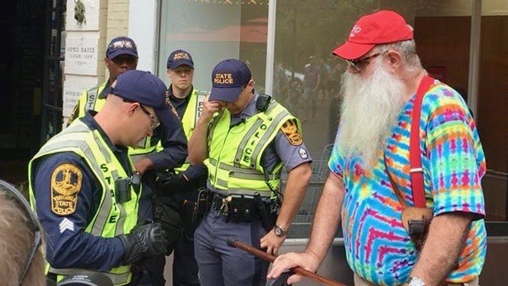 Albemarle County resident John Miska, 68, was arrested on charges of disorderly conduct after an officer looked through an opaque shopping bag and saw razor blades which Miska purchased at the CVS. Miska said he was trying to make a statement against the prohibited items restrictions currently in place downtown.