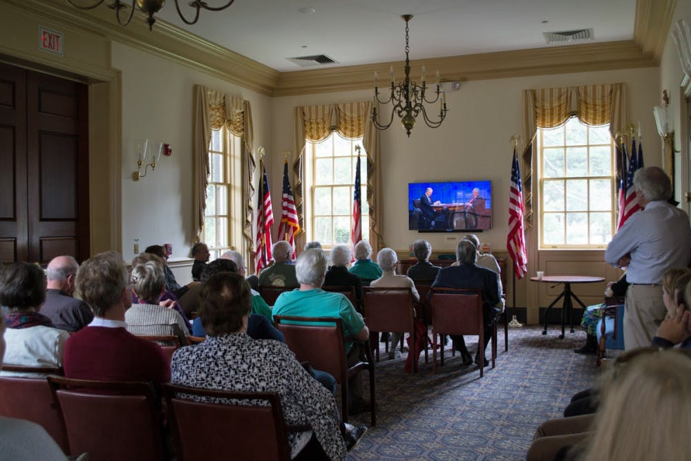 <p>Community members watching American Forum with Blackmon and Kristol.&nbsp;</p>