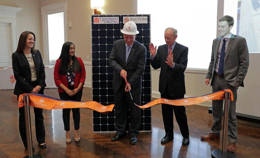 From left, Deputy Secretary of Natural Resources for the Governors Office Angela Navarro, U.Va. student Suchita Chharia, Governor Terry McAuliffe,  U.Va. Executive Vice President and COO Pat Hogan and Sun Tribe Solar co-foiunder Taylor Brown were part of a ribbon cutting ceremony for new 126KW-AC solar panel array installation on the roof Clemens Library Tuesday at the University of Virginia in Charlottesville, Va. Sun Tribe Solar partnered with U.Va. on the project. The ceremony was part of U.Va.'s Earth Week celebration. Photo/Sun Tribe Solar