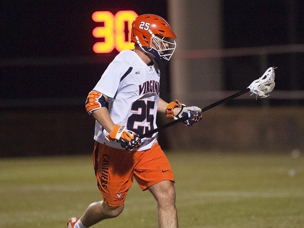 Senior defenseman Scott Hooper started 13 of 15 games as a freshman, and is now captain of the Cavaliers.