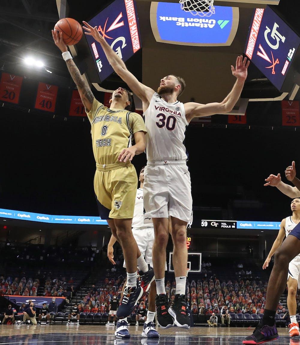 <p>Virginia senior forward Jay Huff blocks Georgia Tech junior guard Michael Devoe's shot</p>