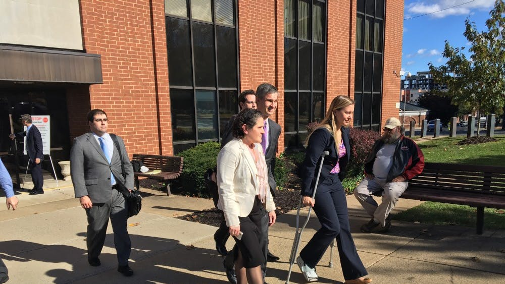 Eramo exits the courthouse after the jury finds in her favor.