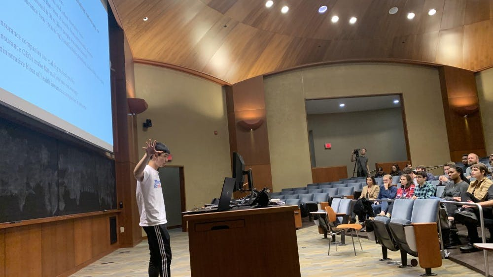 Fourth-year College student John Han advocated the case for healthcare for all during the discussion.