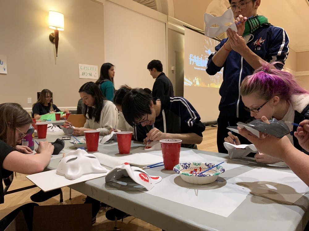 Students painted fox-shaped masks at one of the booths, an animal that holds traditional value in Japanese culture.
