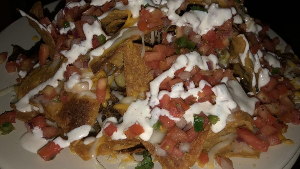 Asado serves classic Mexican dishes like their Fully Loaded Nachos.