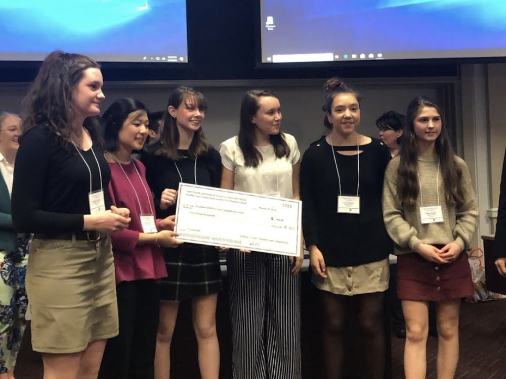 "The winning HMSA team received copies of the book ""Mountains Beyond Mountains"" by Tracy Kidder and $500."
