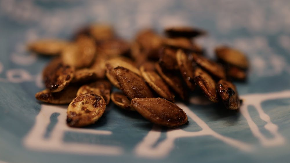 Roasted pumpkin seeds are easy to make, and they can be the perfect snack for second-round midterm cramming.