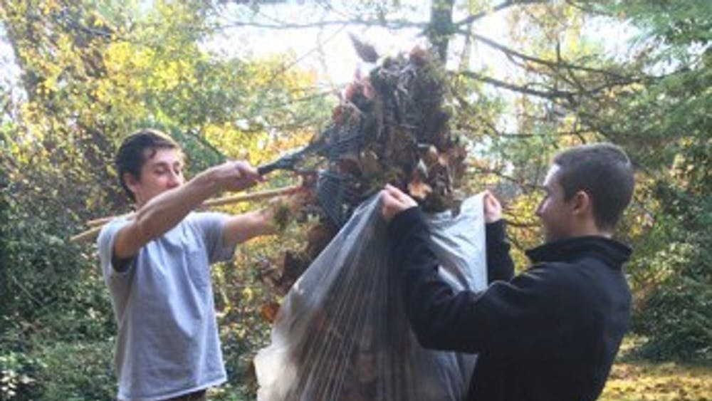 Student volunteers participate in the Habitat for Humanity's annual Rake-a-Thon.