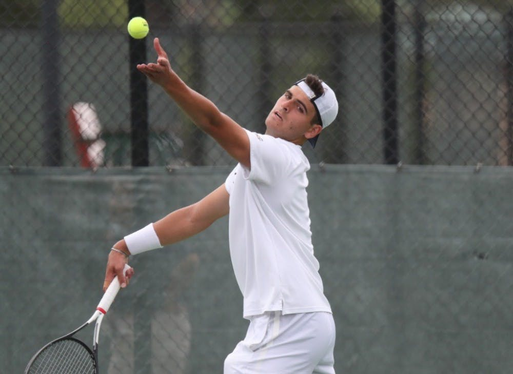 <p>Freshman William Woodall helped clinch the doubles point for Virginia.&nbsp;</p>