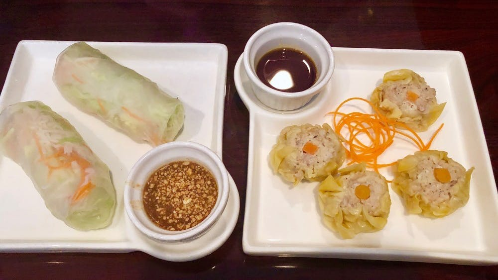 To the left is the Fresh Vegetables Rolls and to the right the Kanom Jeeb — both appetizers offered for under $6.