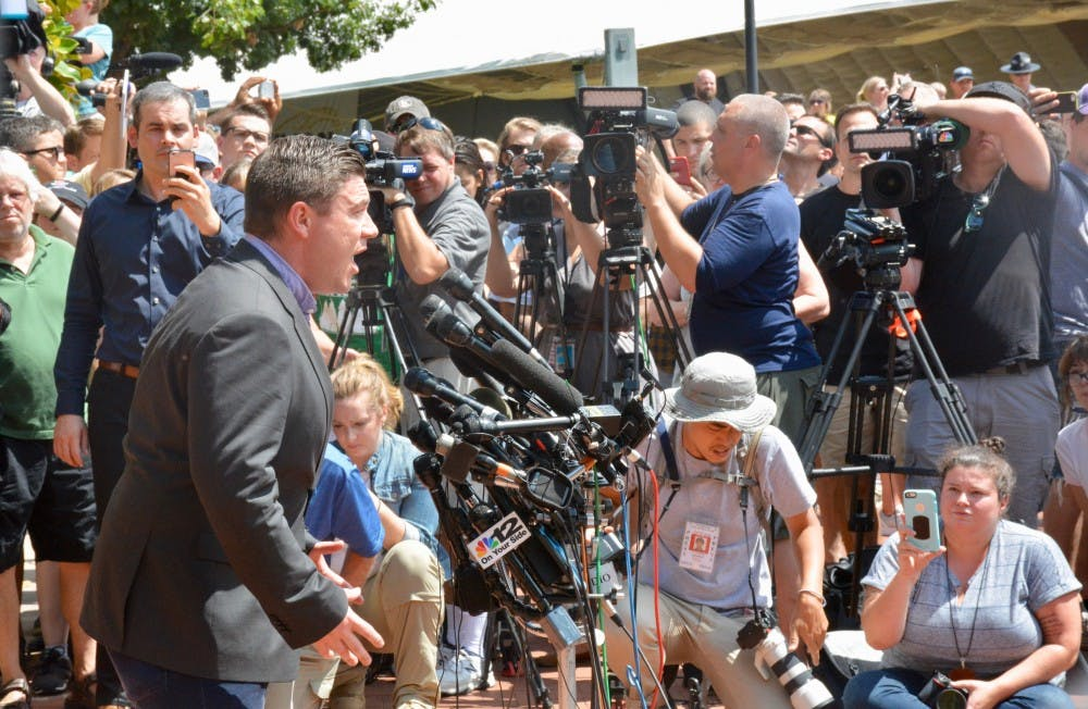 <p>Jason Kessler attempted to hold a press conference Aug. 13, but it lasted only a few minutes before the scene turned into chaos and Kessler was punched in the face by a counter protester. &nbsp;</p>