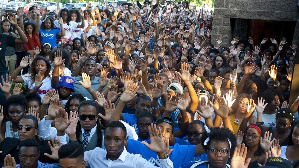 """individualspose for a """"Hands Up, Don't Shoot"""" photo in Augustas part of a national movement in solidarity with Michael Brown."""