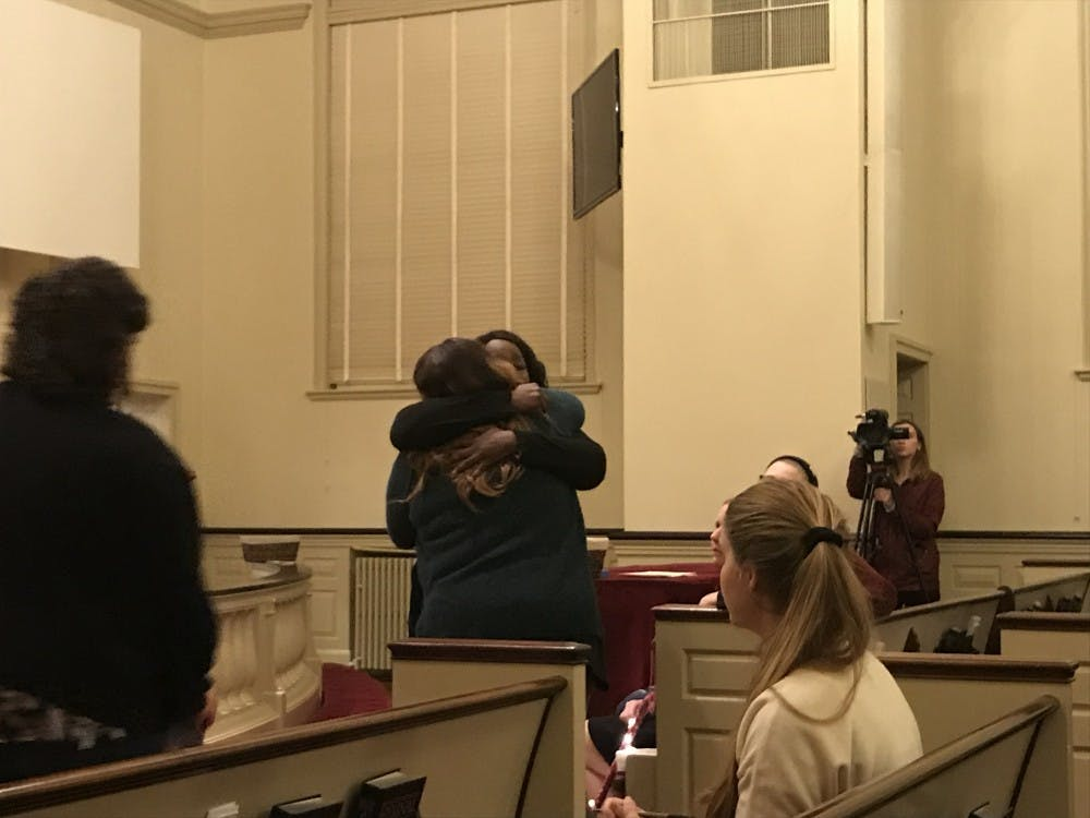 <p>Survivors Lisa, who declined to give her last name, and Tay Washington embrace each other after sharing their stories with attendees at the First United Methodist Church Friday.&nbsp;</p>