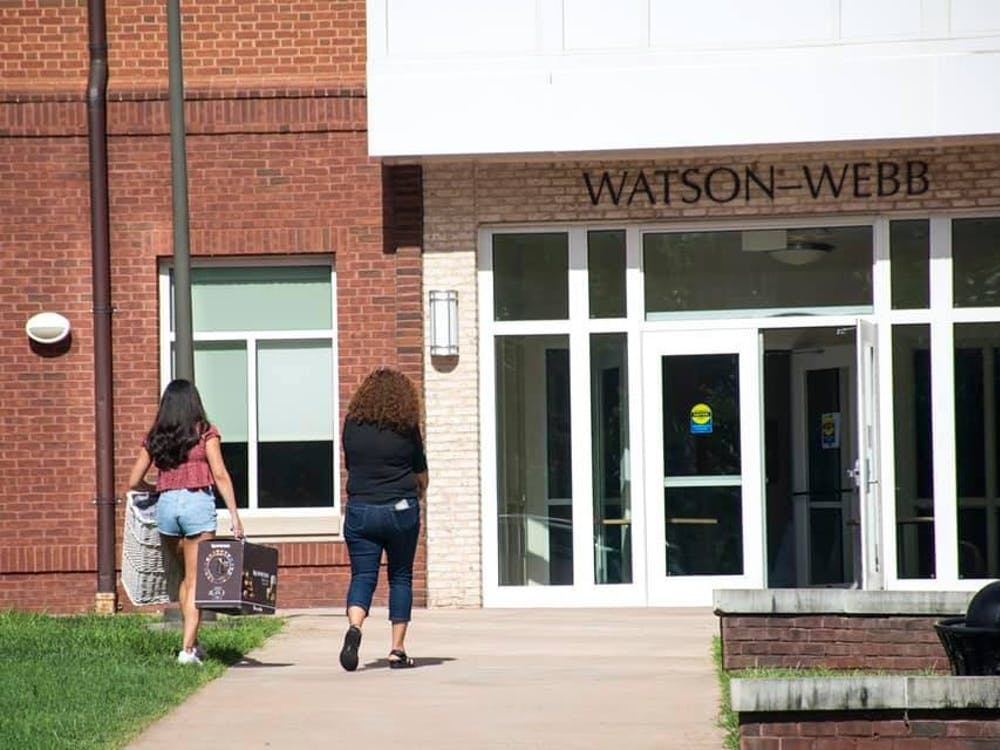 Many resident advisors are living in first-year dorms — sharing communal bathrooms and the close-quarters living situations.