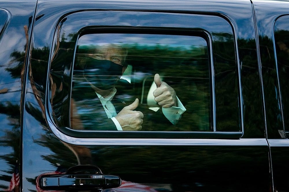 <p>President Donald J. Trump greets supporters during a drive by outside of Walter Reed National Military Medical Center Sunday, Oct. 4, 2020, in Bethesda, Md.</p>