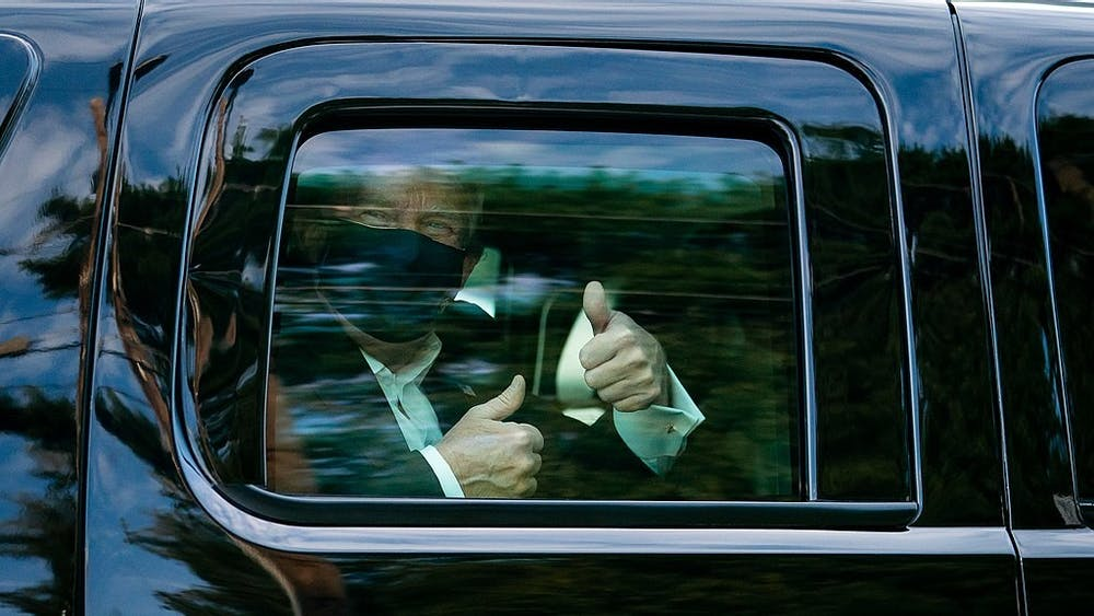 President Donald J. Trump greets supporters during a drive by outside of Walter Reed National Military Medical Center Sunday, Oct. 4, 2020, in Bethesda, Md.