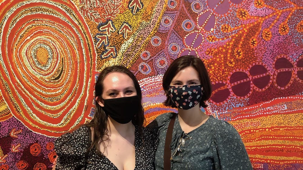 "College graduates Ashley Botkin and Addie Patrick co-curated the Kluge-Ruhe Aboriginal Art Collection's exhibit ""From Little Things Big Things Grow"" along with Henry Skerritt, the Curator of Indigenous Arts of Australia at the Kluge-Ruhe."