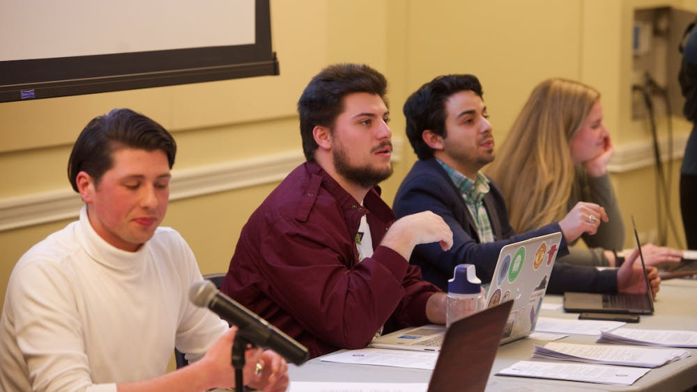 Members of the current Executive Board for Student Council, presiding over a meeting.