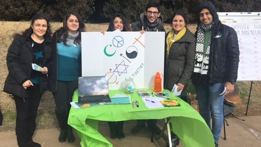 Students from the Persian Cultural Society and Iranian Student Association tabling to raise awareness for green card, visa holders impacted by Trump's latest immigration order.