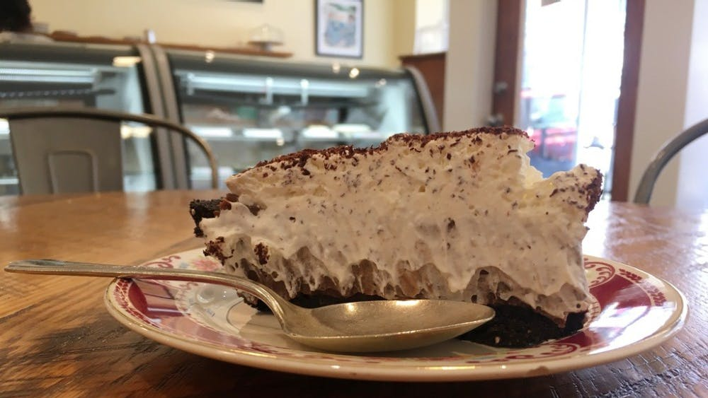 The dark chocolate cream pie has an Oreo-like crust and a dark chocolate, extremely thick and creamy center.