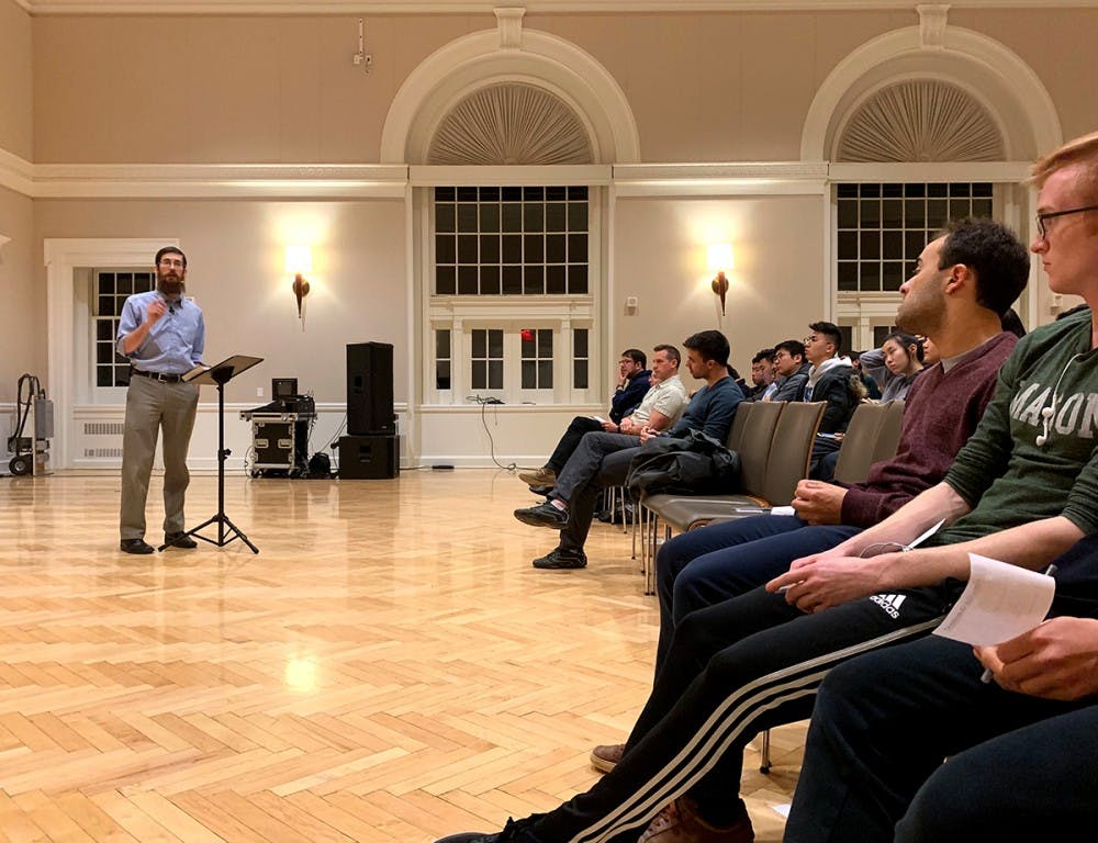 "<p>Speaker Nathan Rittenhouse addresses the question ""Is Happiness Sustainable?"" at the Newcomb Ballroom Feb. 20.</p>"