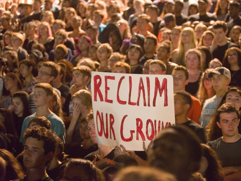 Students gather on the Lawn during the BSA's march to reclaim Grounds.