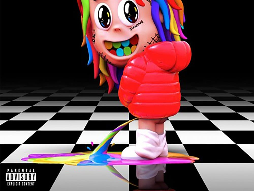 """With the premature release of """"DUMMY BOY,"""" early due to leaks and artist 6ix9ine's recent arrest, fans wonder how they let the candy-colored content creator get this far."""