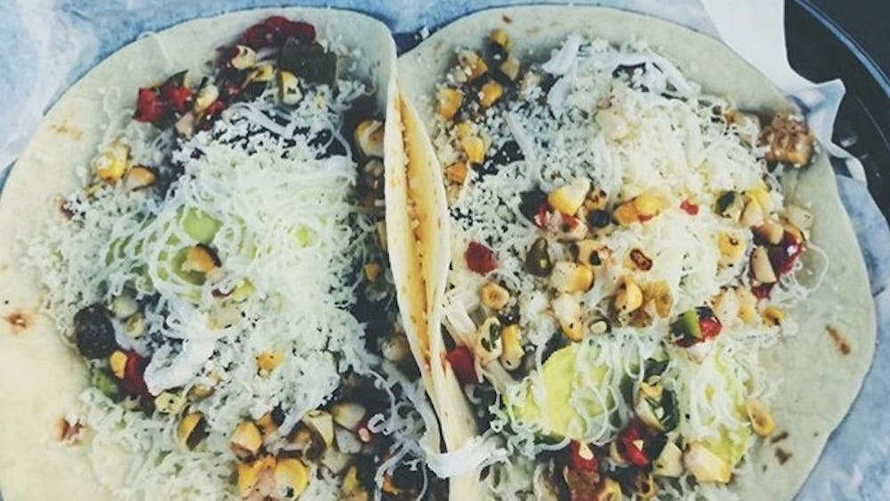 A student instagram account features Brazos Tacos in a post.