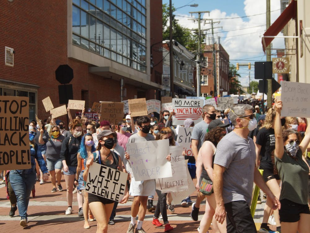 Several hundred protesters converged on downtown Charlottesville Saturday afternoon as part of the nationwide demonstrations to show outrage over the murder of George Floyd. (CD Photo // Sophie Roehse)