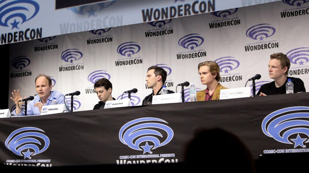 """The cast of """"Tolkien"""" promotes the film at the 2019 WonderCon in Anaheim, California."""