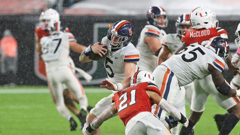 Sophomore quarterback Brennan Armstrong had a quick start to the game, leading Virginia on a 64-yard touchdown drive, but faltered late under slippery conditions.