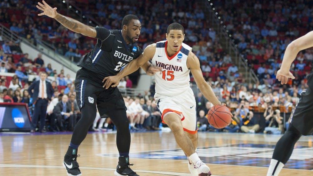 Senior guard Malcolm Brogdon drives past Roosevelt Jones. With Saturday's performance, Brogdon is now the ninth-most prolific scorer in Virginia basketball history.